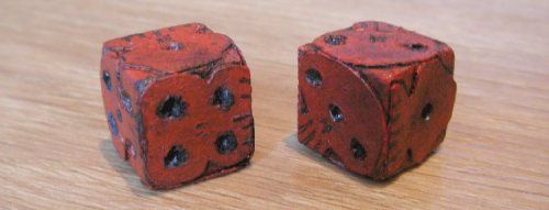 The left one is the new one. Both dice 1.5cm.