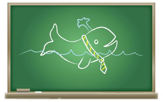 Chalk drawing of cartoon whale on blackboard